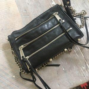 Black zipper cross body bag
